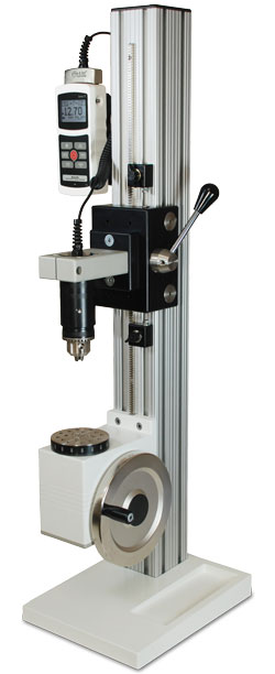 The TST vertical manual torque test stand is shown with a 5i force/torque indicator and Series R50 torque sensor.