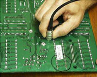 Measurement of conformal coatings on printed circuit boards