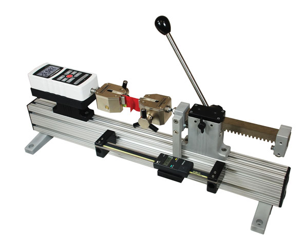 The TSA750H is shown in a typical peel testing application with Series 5 digital force gauges and pair of G1061 wedge grips.