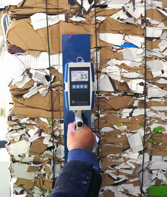 RP6 Moisture Recycled Paper Moisture Meter measuring a bale of paper