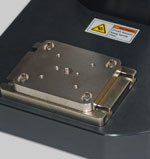 Optional AC1054 mounting plate features three center hole sizes - #10-32, 5/16-18, and 1/2-20. An array of four 1/4-28 holes is also provided.